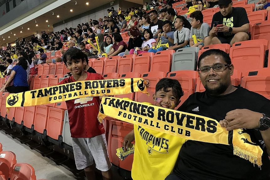 Farzeel Falli, a Tampines Rovers fan since the S-League started in 1996, with his nephews (from left) Hussayn and Safyn at their match against Home United at Our Tampines Hub last night.