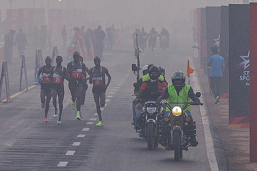 Runners taking part in last year's Delhi Half Marathon in the Indian capital. This year's run is going on as planned today, despite suggestions that it should be cancelled.