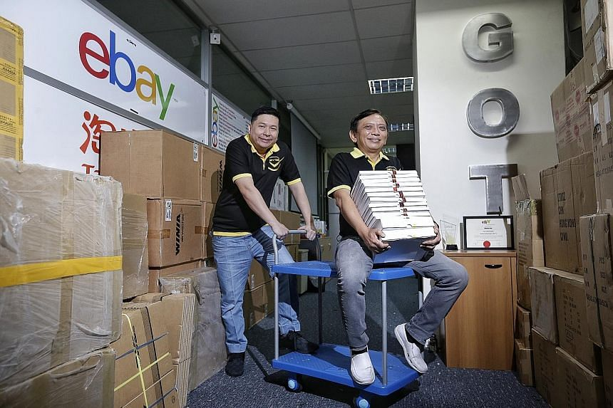 Watch retailer Gift Time, whose founders are Mr Jason See (far left) and Mr Jeson Wu, is one of the top-performing cross-border-trade sellers on eBay in Singapore. Its top markets are Europe, the US and Australia, which helped the company to make abo