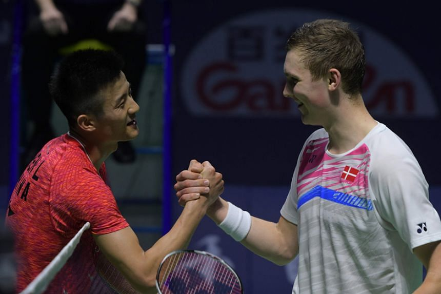 Olympic champion Chen Long shakes hands with Viktor Axelsen of Denmark after defeating the world No.1 to win the China Open for a fourth time on Sunday (Nov 19).