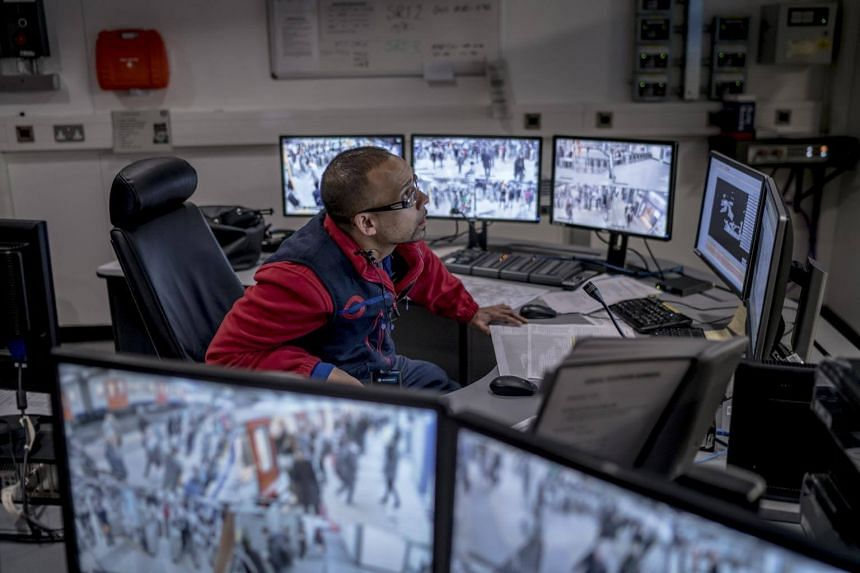 A London Underground employee monitors the feeds in a control room at Victoria Station.