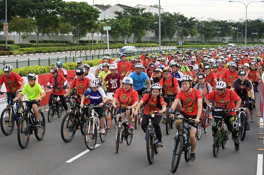 Cyclists taking part in the OCBC Cycle The Straits Times Ride being flagged off at the National Stadium on Sunday (Nov 19).