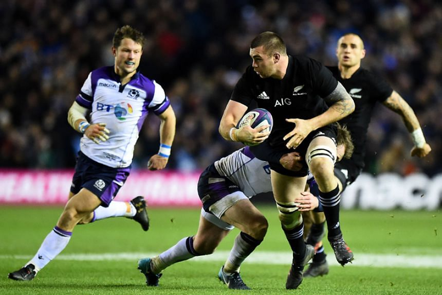 New Zealand's Liam Square (right) is brought down during the international rugby union test match between Scotland and New Zealand at Murrayfield stadium in Edinburgh on Saturday (Nov 18).