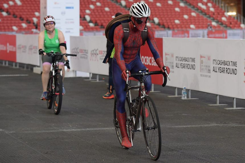 Teacher Glen Liang followed the superhero theme of the OCBC Cycle, taking part in a Spider-Man costume.