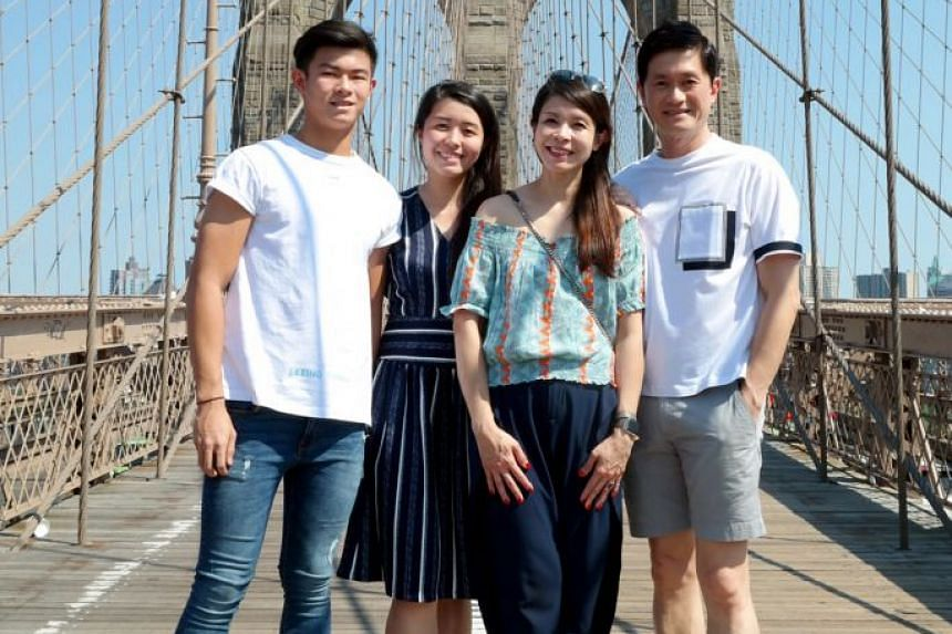 Bynd Artisan co-founders James Quan and wife Winnie Chan with their children Josh and Vera at the Brooklyn Bridge in New York. Mr Quan says the children listen in when the couple chat at home about the economy, businesses, human capital and entrepren