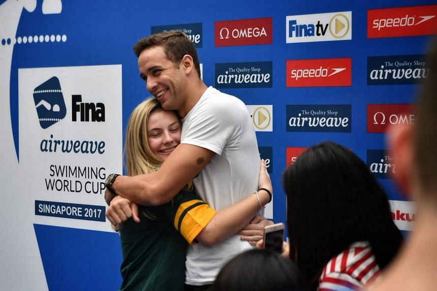 13-year-old fan, Ms Julia Waterton, getting a hug from Chad le Clos during the meet-and-greet session after the Fina World Cup press conference.