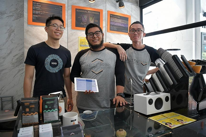 (From left) Mr Alex Ng, senior account manager at accounting software firm Xero, Upside Down Coffee Alternatives owner Rashyd Haniff and head barista Ivan Tong at the cafe in Amoy Street. Upside Down Coffee has adopted digital business solutions, inc