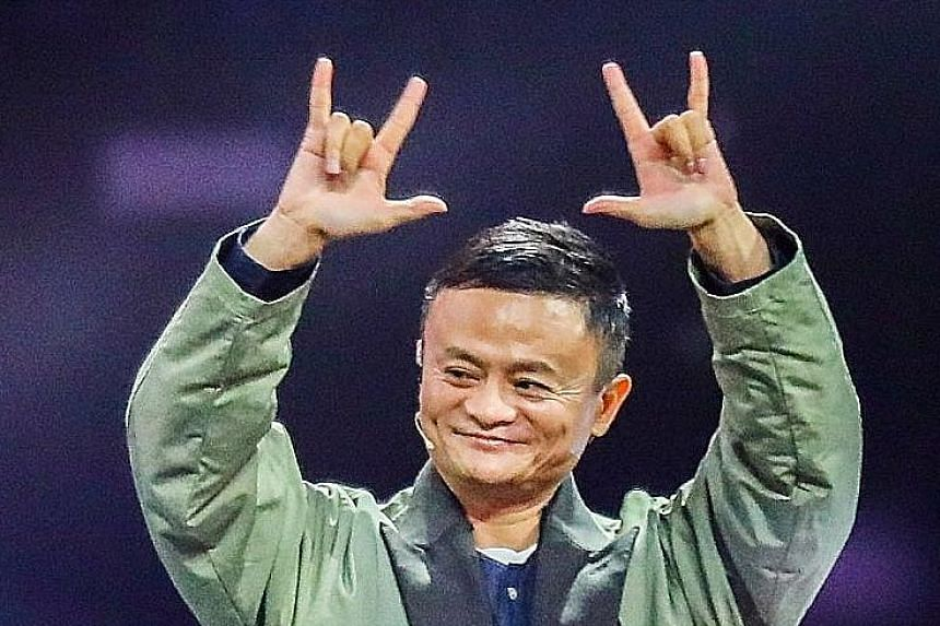 Alibaba founder Jack Ma (left) acknowledging fans after showing up with the main cast of his movie Gong Shou Dao during a gala event in Shanghai on Nov 11. The billionaire, seen here (right) speaking during his firm's inaugural Gateway '17 conference