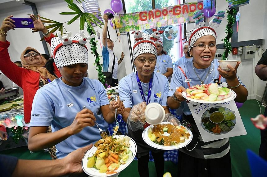 From left: Ms Masyitoh, 38, Mrs Rodiyah Pardi, 48, and Mrs Istiqomah, 44, members of the champion team from Indonesia, introducing their dish, gado-gado salad, to judges at the first International Food Fair yesterday.