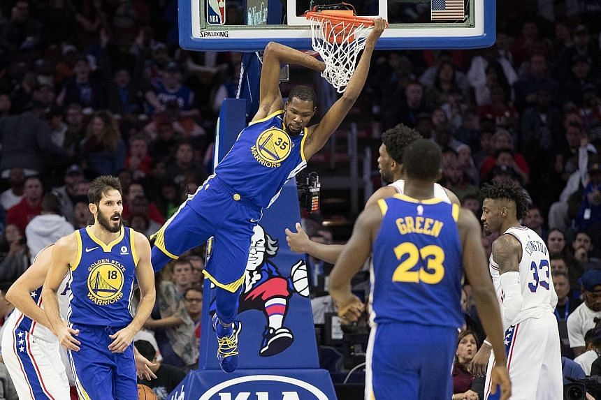 Golden State Warriors forward Kevin Durant dunking against the Philadelphia 76ers during their 124-116 win on Saturday. They recorded the NBA's largest comeback of the season and their fourth, after trailing by double digits.