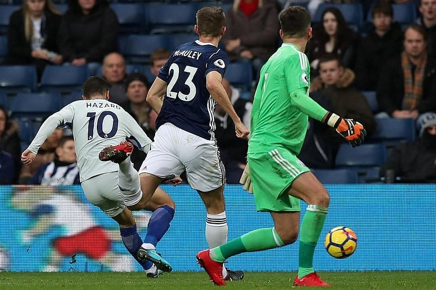 Chelsea forward Eden Hazard scoring his second against West Brom after rounding goalie Ben Foster. The English champions will now have to contend with a gruelling run of eight more games in a month.