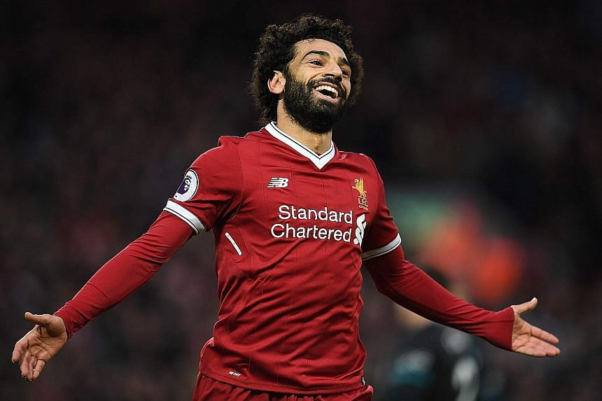 Liverpool's Egyptian midfielder Mohamed Salah celebrates after scoring his second goal in his side's emphatic 3-0 home win against Southampton on Saturday.