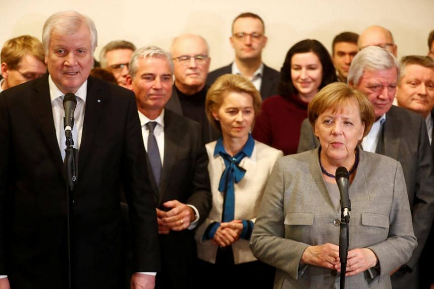 German Chancellor Angela Merkel (right) of the Christian Democratic Union and Christian Social Union leader Horst Seehofer speak to media after the exploratory talks about forming a new coalition government collapsed in Berlin.