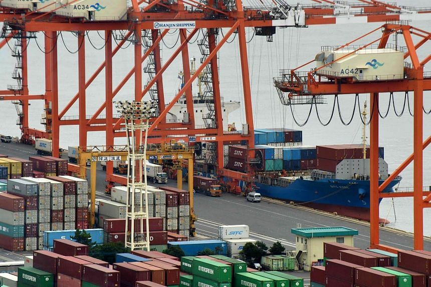 A container wharf is seen in Tokyo port. The trade figures followed data that showed last week Japan's economy expanded at an annualised rate of 1.4 per cent in the third quarter.
