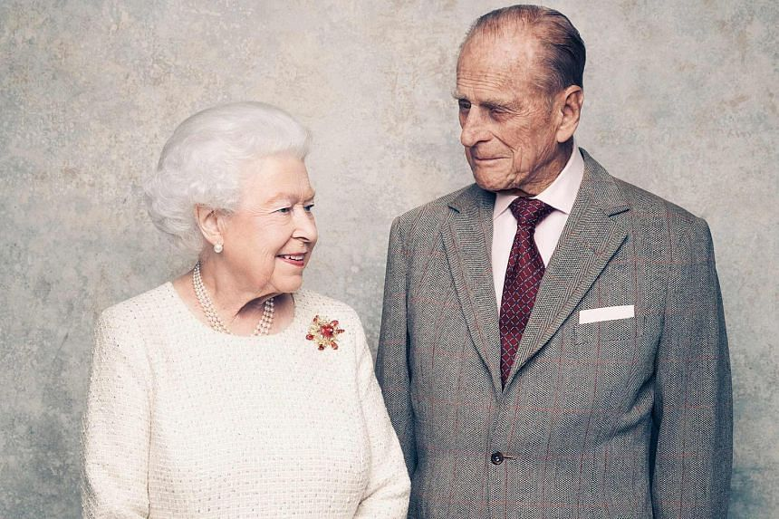 Britain's Queen Elizabeth II and her husband, Britain's Prince Philip, Duke of Edinburgh are pictured in the third of a sequence of three portraits in the White Drawing Room at Windsor Castle, to mark their Platinum Wedding Anniversary.