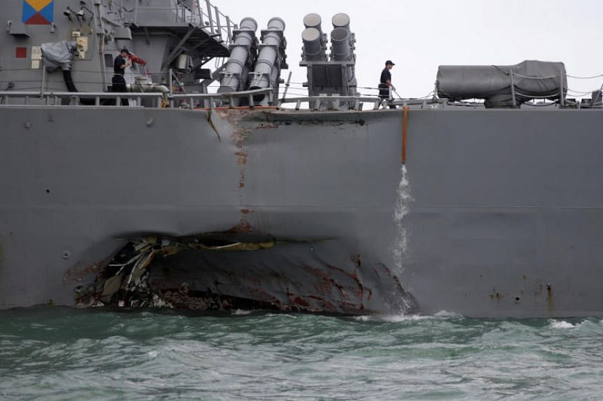 The US Navy guided-missile destroyer USS John S. McCain is seen after a collision, in Singapore waters on Aug 21, 2017.