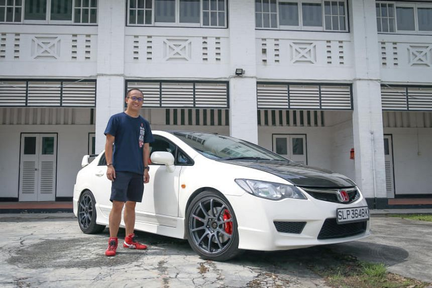Aaron Hia, an automotive product trainer, with his Honda Civic Type R car.