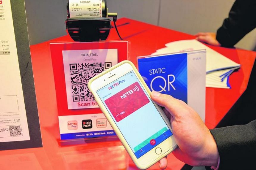 Consumers of seven major banks here will soon be able to make cashless payments at hundreds of hawker stalls, in what is seen as a step towards creating a unified payment system in Singapore.