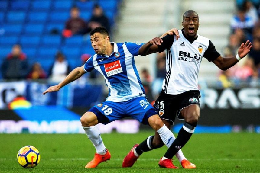 Valencia's French midfielder Geoffrey Kondogbia (right) in action against Espanyol's Javi Fuego (left) during the Spanish Primera Division soccer match between RCD Espanyol and Valencia CF in Barcelona, Spain, on Nov 19, 2017.