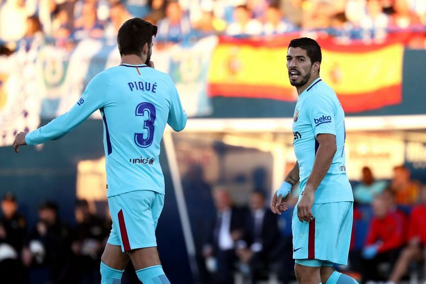 LaLiga leaders Barcelona will appeal the yellow cards handed to defender Gerard Pique (left) and striker Luis Suarez (right) during the 3-0 win at Leganes, on Nov 18, 2017.