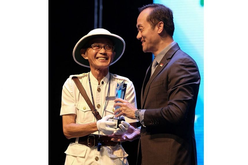 Mr Sebastian Joo, 73, a service assistant at Sheraton Towers Hotel, receiving a trophy for being a Singapore Hotel Association (SHA) Outstanding Star award nominee at the Excellent Service Award Star Presentation Ceremony for the Hospitality Industry