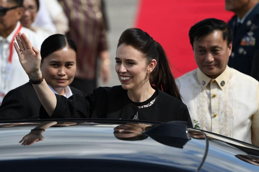 New Zealand's Prime Minister Jacinda Ardern waves upon arriving at Clark International airport in Pampanga province, north of Manila for the 31st Asean Summit.