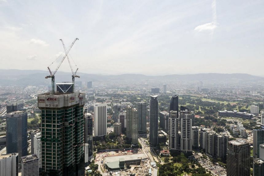 A luxury hotel and shopping mall complex is seen under construction from Petronas Twin Towers in Kuala Lumpur, Malaysia on March 13, 2017.