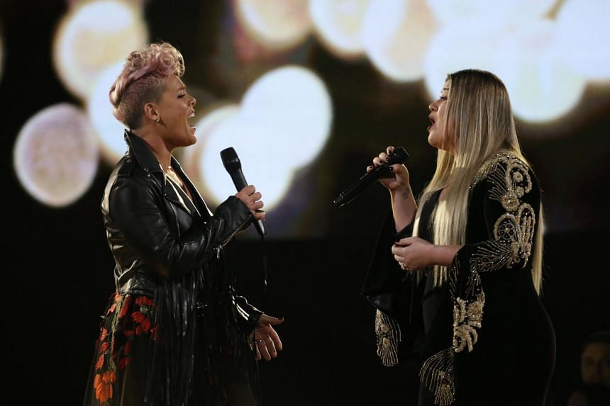Pink (left) and Kelly Clarkson sang REM's Everybody Hurts, dedicated to first responders and victims of the recent hurricanes and wildfires that have ravaged parts of US.