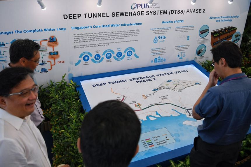 Guests looking at an informational map of the Deep Tunnel Sewerage System Phase 2 during the groundbreaking ceremony. ST PHOTO: MARK CHEONG