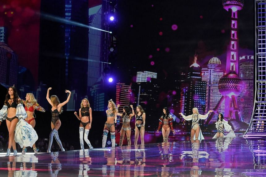 US model Lily Aldridge (left) leads out other models as they present creations during the Victoria's Secret Fashion Show in Shanghai on Nov 20, 2017.