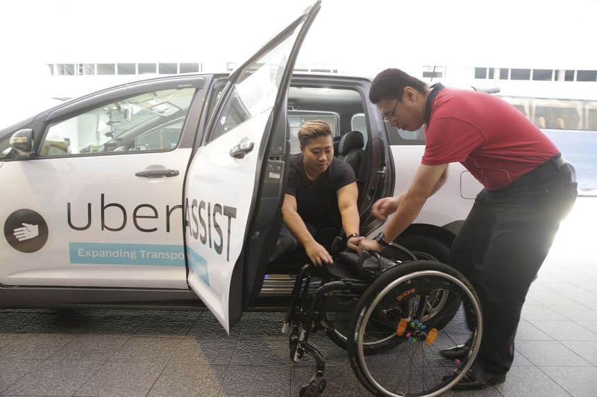 National para-swimmer Theresa Goh trying out the uberAssist option when it was launched in October 2015.