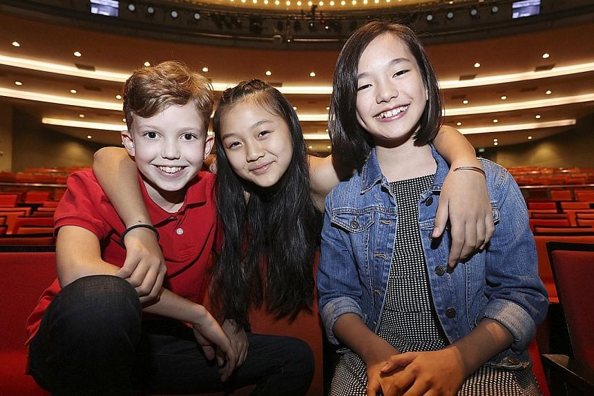 Playing the von Trapp children are (from far left) Max Makatsaria, Samantha Lee and Chloe Choo.