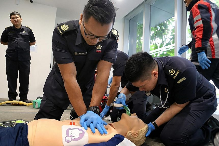 Singapore Civil Defence Force paramedics performing CPR at a media demonstration of new intervention techniques.