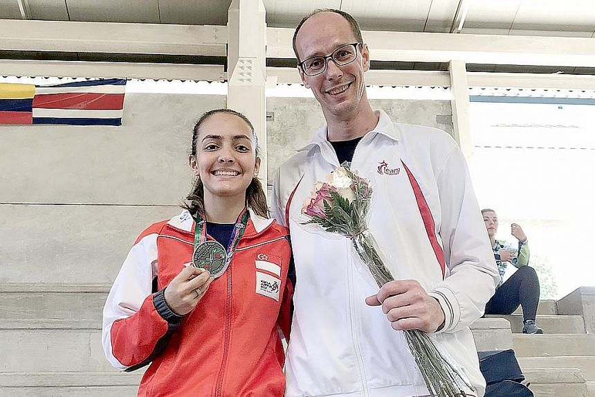 National fencer Amita Berthier with her coach Ralf Bissdorf at the Guatemala leg of the Junior World Cup. The 16-year-old clinched the Republic's first individual medal in the event with a silver and is set to move up to No. 12 in the junior world ra