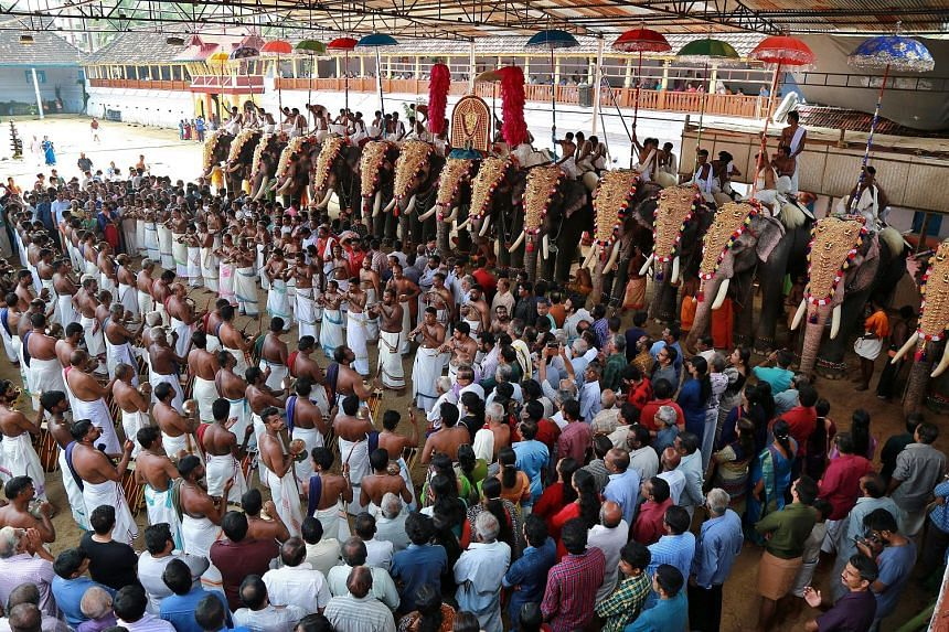 Artists beating drums and blowing trumpets during the annual eight-day Vrischikolsavam festival, which features a colourful procession of decorated elephants and drum performances, at the Sree Poornathrayeesa temple in Kochi, India, yesterday. The fe