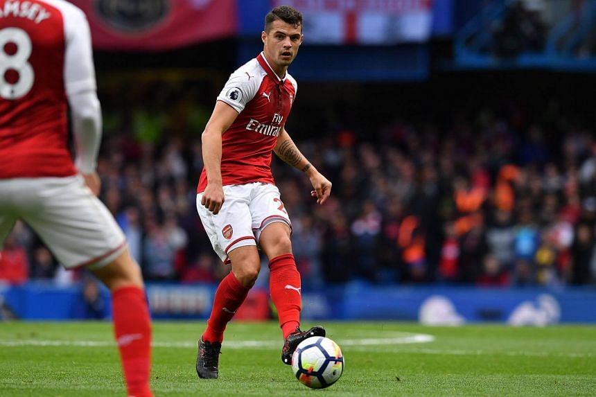 Arsenal's Swiss midfielder Granit Xhaka passes the ball during an English Premier League football match at Stamford Bridge in London on Sept 17, 2017.
