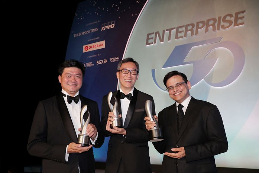 Mr Lam Keng Yew (centre), managing director of Onn Wah Precision Engineering, which clinched top prize in the Enterprise 50 (E50) Awards on Nov 21, 2017. With him are Mr Lee Yong Miang (left), managing director of Expand Construction, which came in t