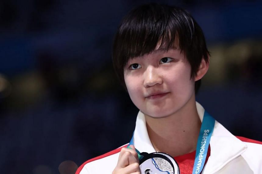 China's Li Bingjie celebrates on the podium after the women's 800m freestyle final during the swimming competition at the 2017 Fina World Championships in Budapest, on July 29, 2017.