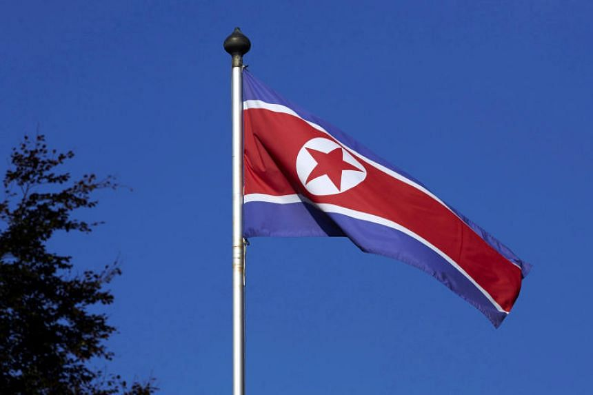 A North Korean flag flies on a mast at the Permanent Mission of North Korea in Geneva on Oct 2, 2014.