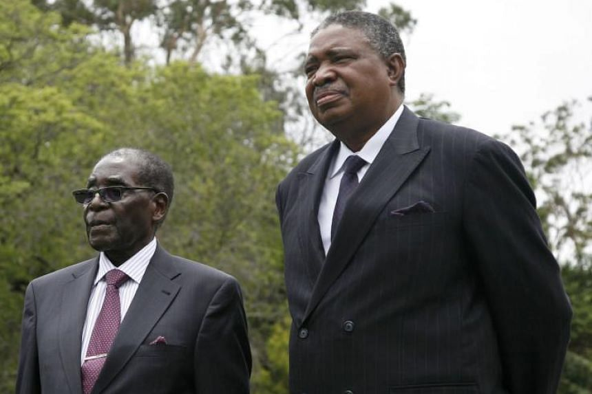 (From left) Zimbabwean President Robert Mugabe Zimbabwean and then vice President, Emmerson Mnangagwa outside State House, Harare, Zimbabwe, on Dec 12, 2014.