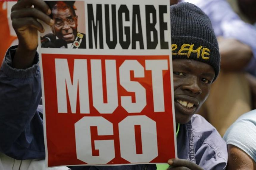 People gather at a opposition party rally outside the state parliament in preparation for the proposed impeachment of president Robert Mugabe in Harare, Zimbabwe on Nov 21, 2017.