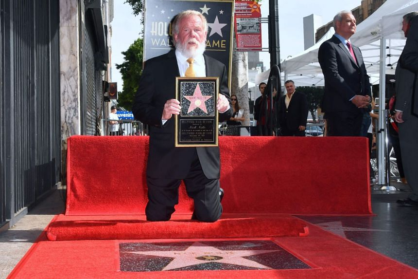 Actor Nick Nolte poses on his Hollywood Walk of Fame Star.
