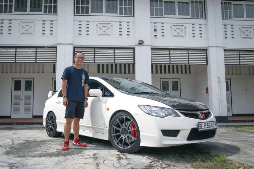 Mr Aaron Hia, 32, a product trainer with a car distributor, with his Honda Civic Type R car.