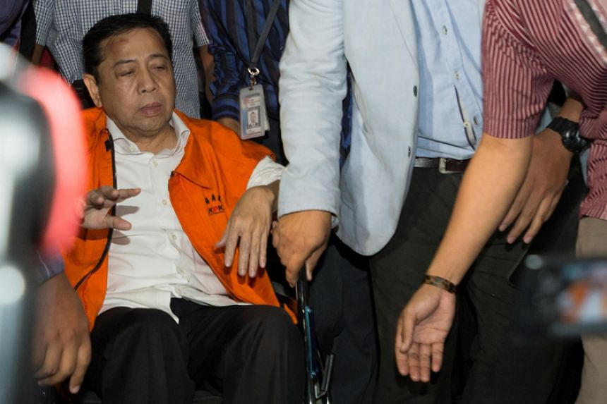 Indonesia's Speaker of the House Setya Novanto, identified as a suspect in a corruption case, arrives at the Corruption Eradication Commission (KPK) building in Jakarta on Nov 19, 2017.
