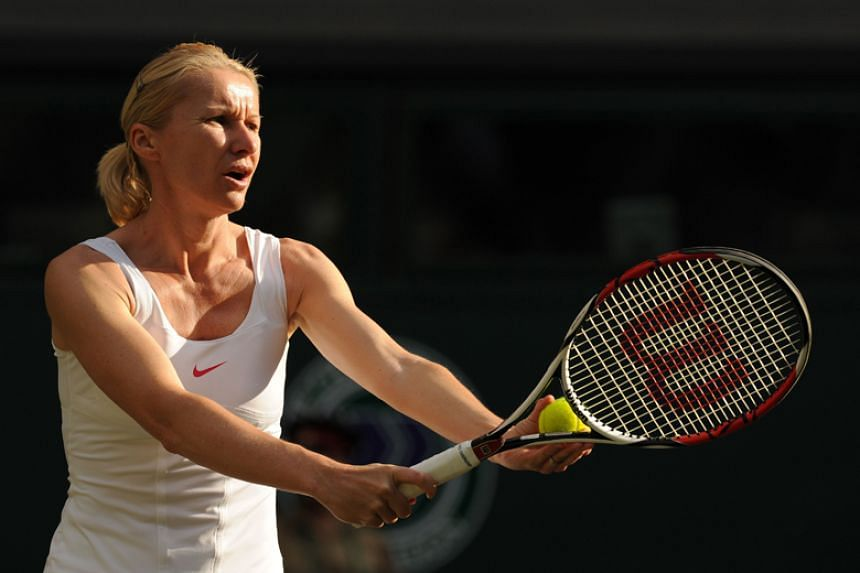Czech Republic's Jana Novotna playing a ladies' invitation doubles match in the Wimbledon Tennis Championships at the All England Tennis Club in London on July 2, 2010.