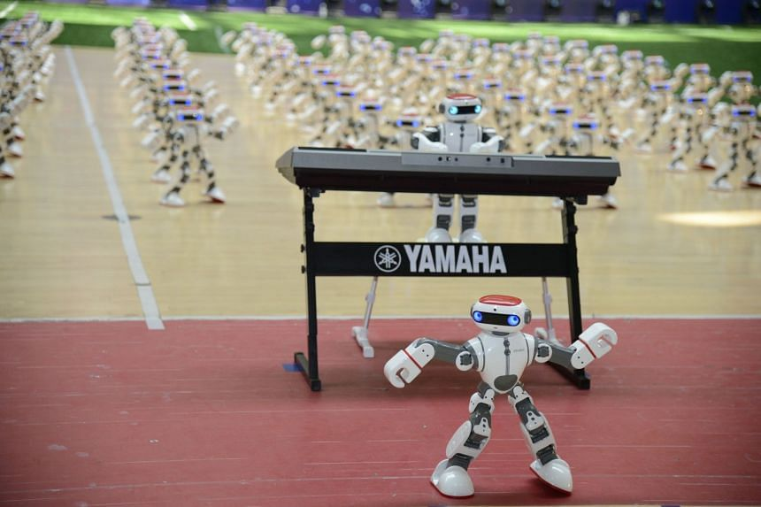 Robots perform during a robot contest in Dezhou, Shandong province, China.