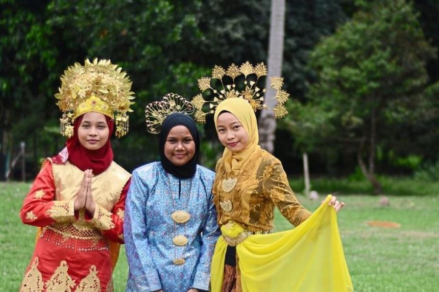 Young girls showing off colourful traditional costumes at Kampung Sungai Buah in Dengkil.