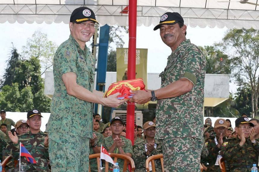 Singapore Chief of Army, Major-General Melvyn Ong hands over the Asean Armies Rifle Meet (AARM) flag to Chief of Army of the Malaysian Armed Forces, General Dato' Sri Zulkiple Bin Haji Kassim at Nee Soon 500m Range on Nov 22, 2017.