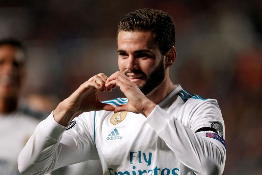 Real Madrid's Nacho celebrates scoring their third goal.