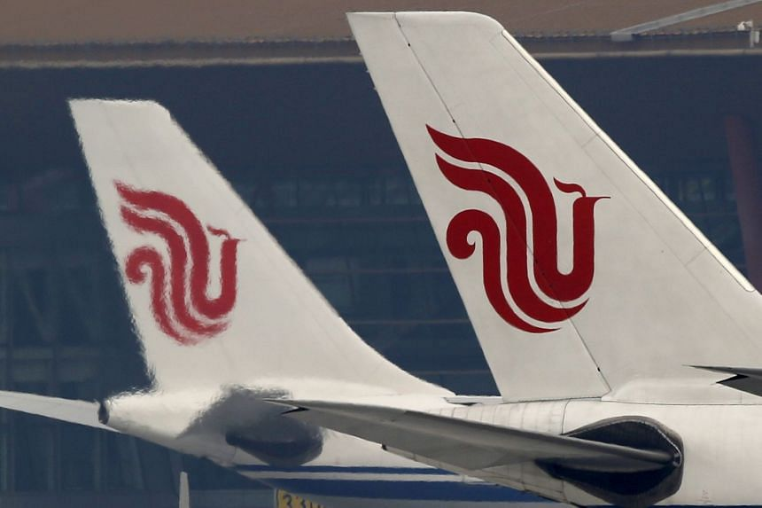 Air China planes are parked on the tarmac of Beijing Capital International Airport.